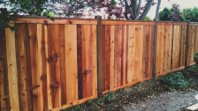 Wood privacy fence giving privacy and security to a back yard