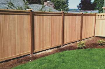 fence repair spokane of a wooden fence made to look like new again