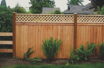 privacy wood fencing with natural stain and decorative top for style