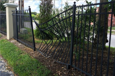 panel-of-wrought-iron-fence-or-alluminum-fence-ran-into-with-a-car-and-damaged-or-bent-and-in-need-of-replacement
