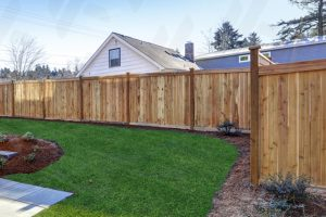 spokane-wooden-fence-with-natural-stain-in-backyard-with-landscaping-and-green-grass